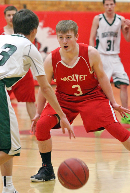 Ely's Carter Gaulke (3) defends as Northeast Range runs its offense in Friday's regular season finale.