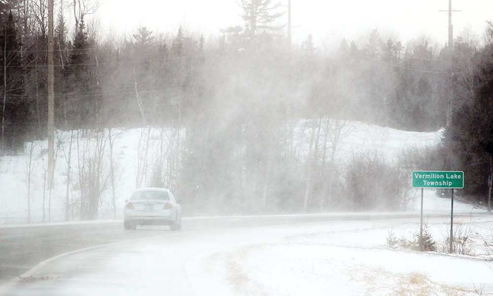 Strong gusts of wind whipped up snow and near-white out conditions on Tuesday on Highway 169 just west of Tower.