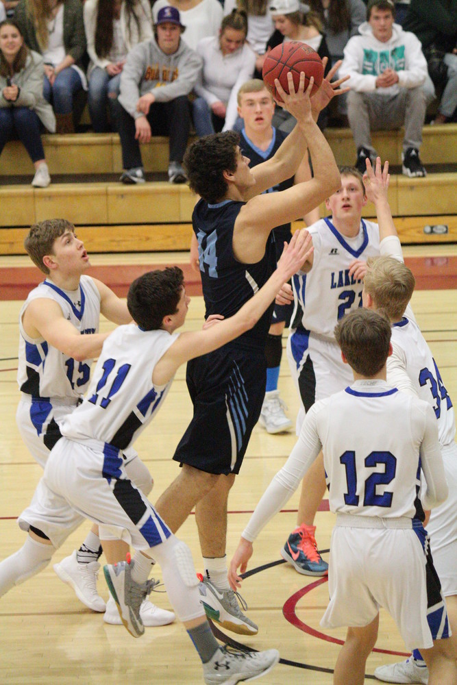 North Woods senior George Bibeau gets a shot off in the lane despite being surrounded by the entire Lakeview Christian Academy defense in Tuesday's Section 7A semifinals. Bibeau scored 10 points to help the Grizzlies earn a 76-44 victory and reach the section finals.