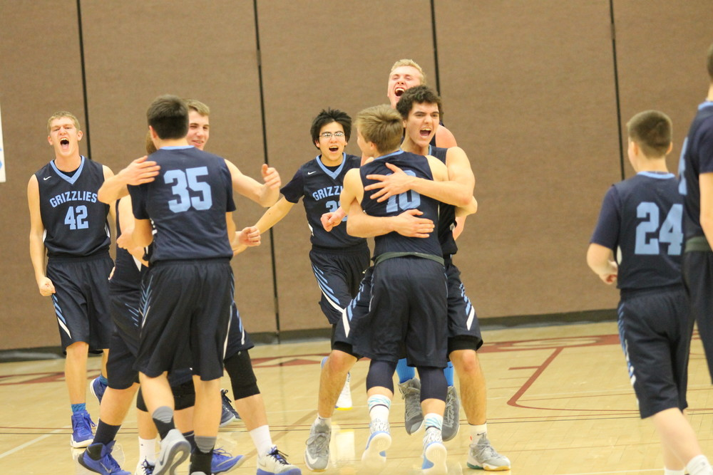 The North Woods boys basketball team sprints to the court to celebrate after wrapping up the Section 7A championship with a dominant   70-55 win over Mountain Iron-Buhl on Friday in Duluth. The victory clinched the Grizzlies' first-ever trip to the state tournament.
