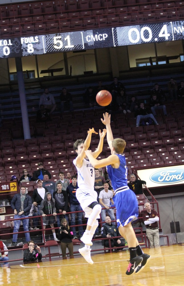 Cade Goggleye's last second heave from beyond half court broke a 51-51 tie and sent North Woods into the state semifinals with a 54-51 win over Central Minnesota Christian on Thursday.