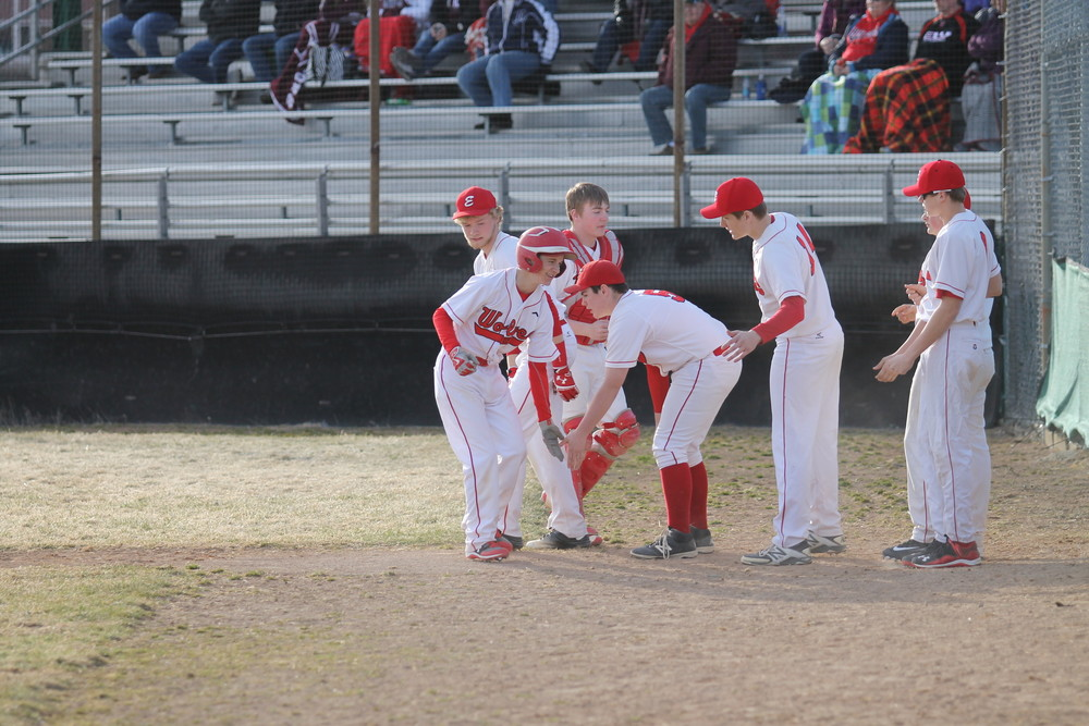 The Ely dugout greets freshman Nils DeRemee after he drove in what proved to be the game-winning run in Friday's season-opening 4-1 victory over Two Harbors.