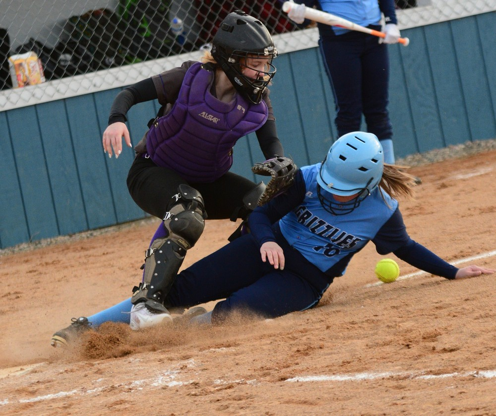 North Woods sophome Maddy Serna slides safely into home in Monday's 10-1 season-opening win over Floodwood.