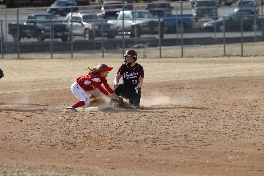 Ely sophomore shortstop Lida Dodge gets a tag down just in time for an out at second base during Friday's season opener versus Two Harbors.