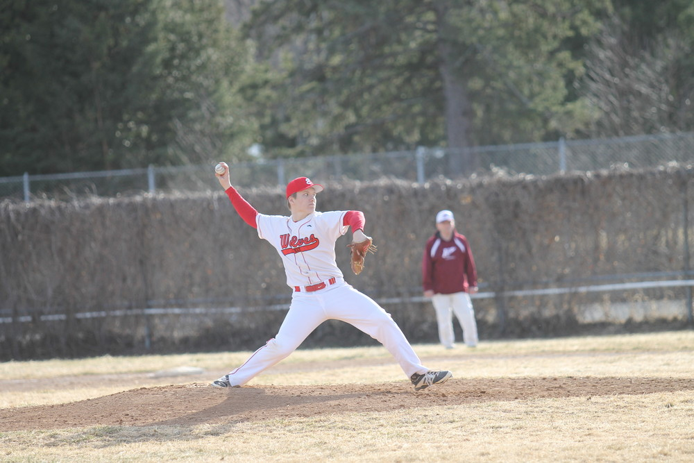 Ely junior Dylan Kienitz delivers a pitch during the Wolves' season opener against Two Harbors. Kienitz threw four innings of scoreless relief to earn the win for Ely, which is now 1-1.