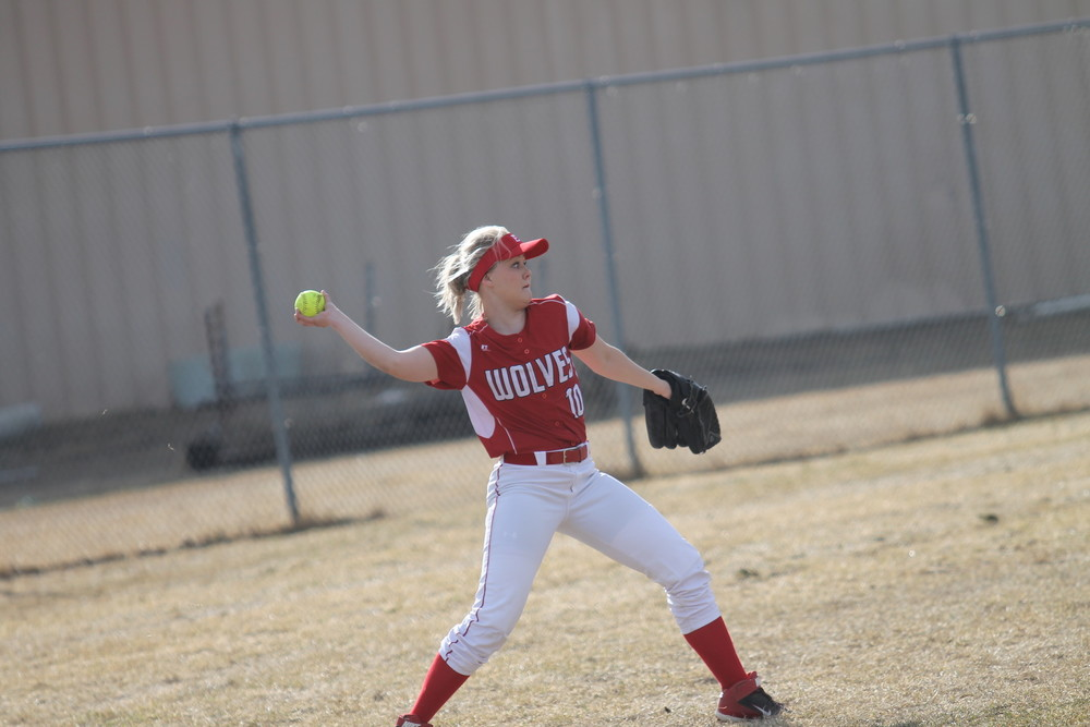 Ely senior center fielder Courtney Kellogg quickly gets the ball back into the infield during the Wolves' season opener versus Two Harbors. Kellogg went on to pick up a hit and a run in Thursday's 5-4 win over Nashwauk-Keewatin.