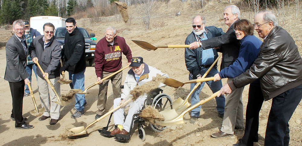 U.S. Rep. Rick Nolan and U.S. Sen. Amy Klobuchar (third and second from right) joined state and local officials last Thursday morning for the groundbreaking on the            long-delayed Hwy. 169 project in Eagles Nest Township. Work is now underway on the project and should continue through summer of 2018.