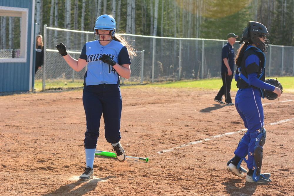 North Woods sophomore Kate Stone crosses the plate in early-season action. The Grizzlies' offense has piled up 55 runs in their first five games, opening the season with a 4-1 record.