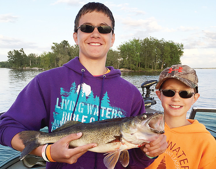 A nice walleye is bound to put big smiles on the faces of young anglers.