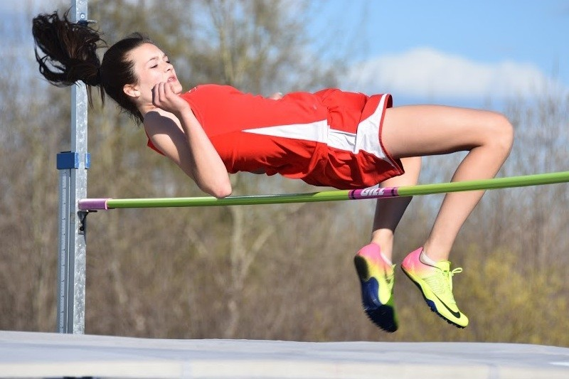 Ely freshman Brielle Kallberg arches over the bar in the high jump during Thursday's Lynae Morrow Invite in Hibbing. Kallberg earned ninth place in the event with a height of 4-feet, 8-inches, while also earning a pair of top-five finishes.