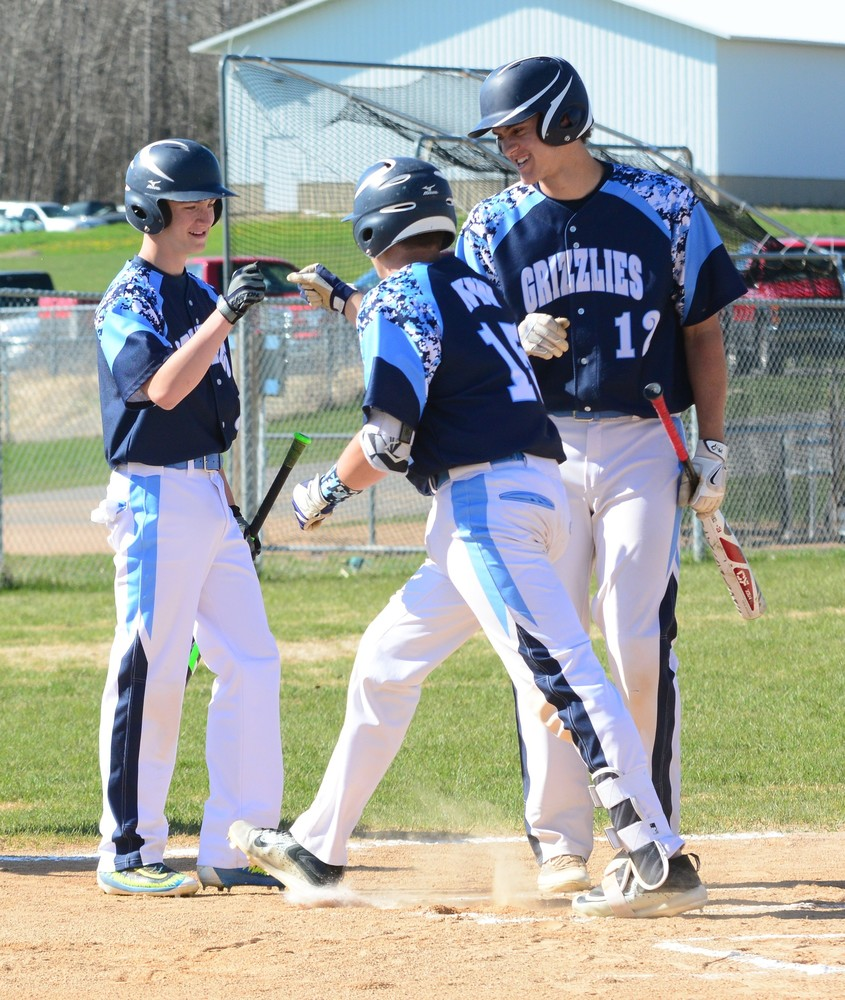 North Woods junior Matthew Schultz (15) is greeted at the plate after scoring a run in Friday's 5-4 home win over Cherry. The Grizzlies have run off six wins in a row to improve their record to 9-3 on the season.