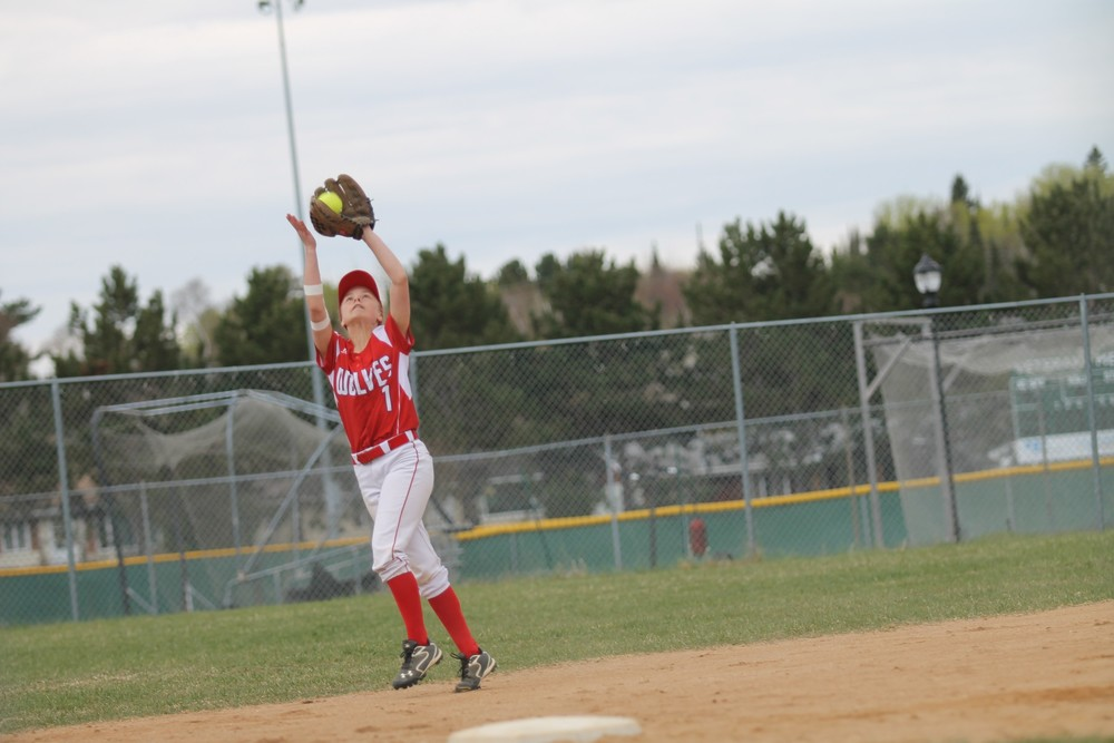 Ely shortstop Lida Dodge squeezes a pop up on Saturday.