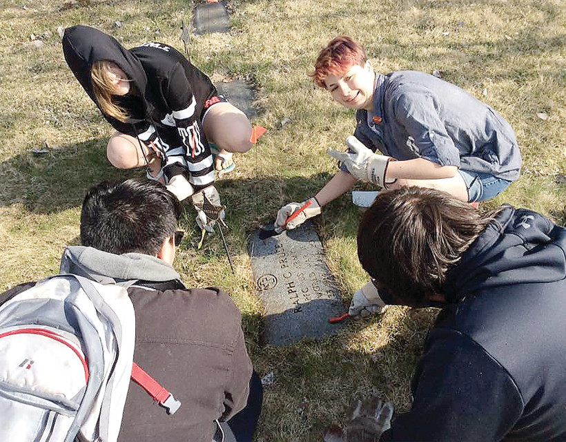 Community service projects are an integral part of the school's educational mission. One long-term project has students cleaning old gravestones at the Tower Cemetery.