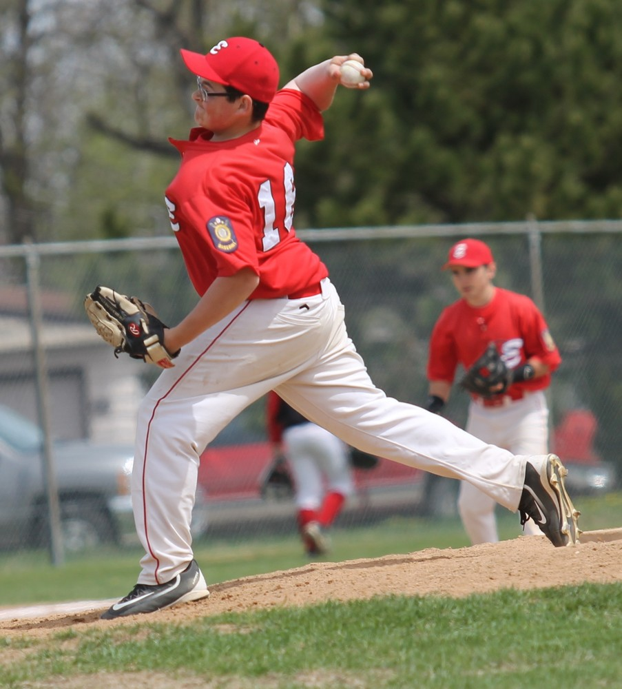 Ely junior Cody Davis pitches the Wolves out of bases loaded trouble in the sixth inning in Friday's home tournament opener, helping the Wolves topple Blackduck 11-5.