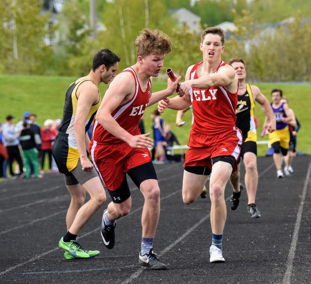 Ely's Izaak Nosbisch hands off to Blaise Lah in the Wolves' second-place 4x400-meter relay during Thursday's Sub-Section 7A North meet. The Wolves advanced   athletes to sections in 17 of 18 events.