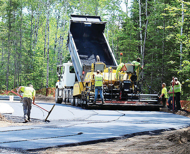 Workers were spreading asphalt last week near the new informational kiosk still under construction in the Lake Vermilion Soudan Underground Mine State Park.