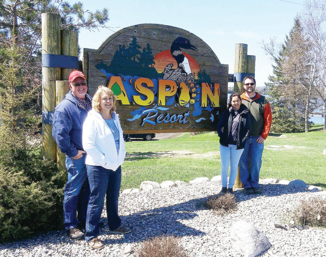David and Cora Downes, with son Cody and daughter-in law Julie, in front of the Aspen Resort on Pelican Lake.