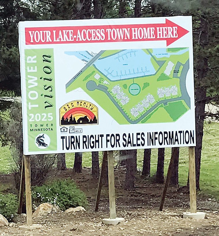 "This recently-erected billboard has generated ""overwhelming"" interest for the town home project, according to realtor Mark Ludlow."