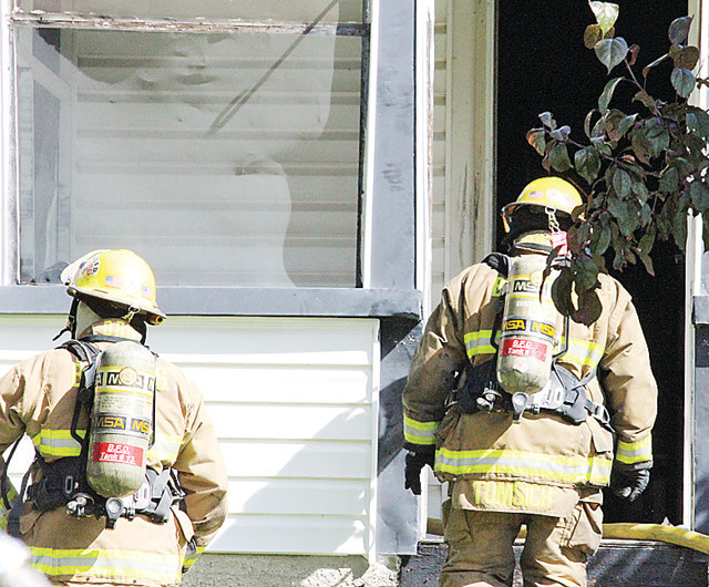 Firefighters entered a Tower smoke-filled residence Wednesday morning where they found an unconscious infant
