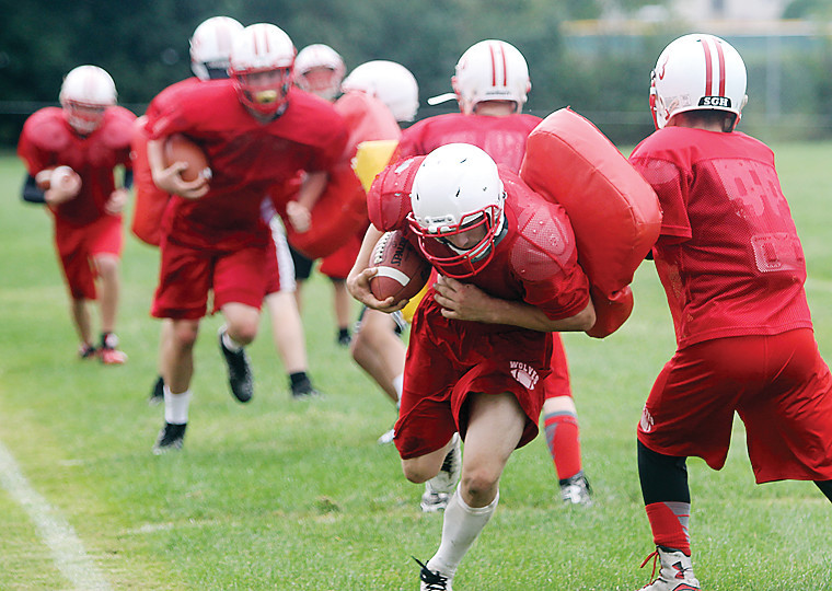 Ely players conduct a hitting drill during a recent practice.