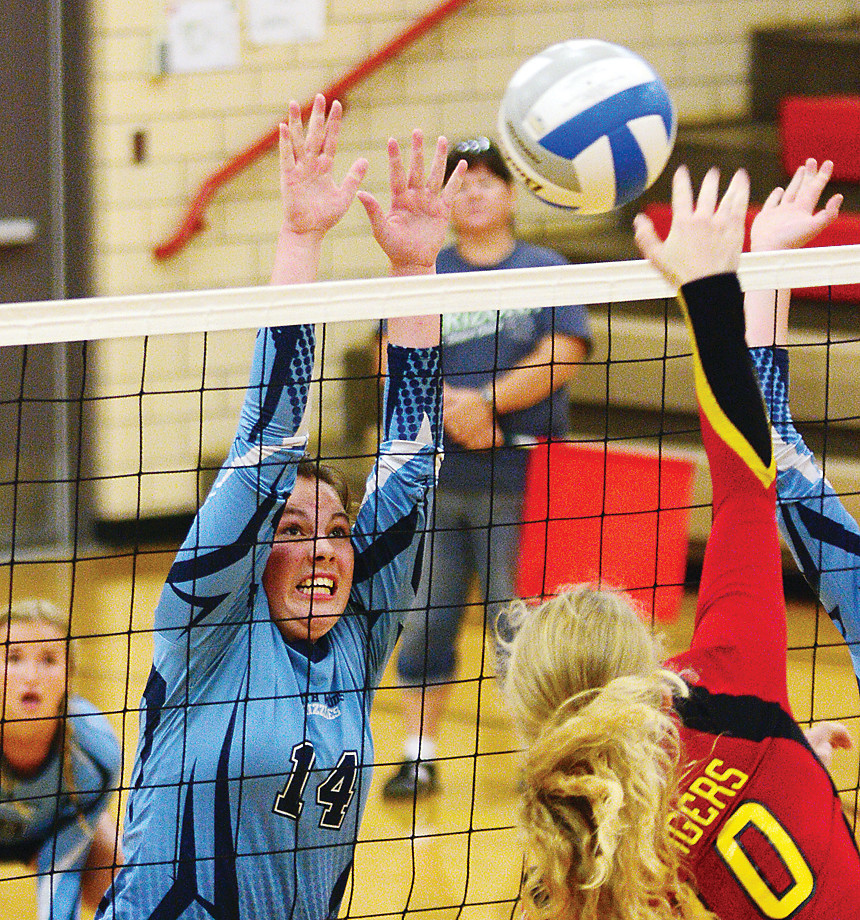 Kate Stone looks determined as she goes up for a block against MI-B.