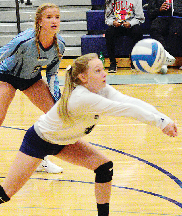 Setter Claire Beaudry notches a dig during Tuesday's match-up with Deer River on Monday.