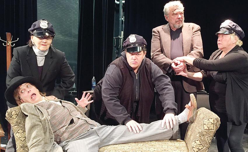 The police arrest Mr. Witherspoon on suspicion of murdering Dr. Einstein.