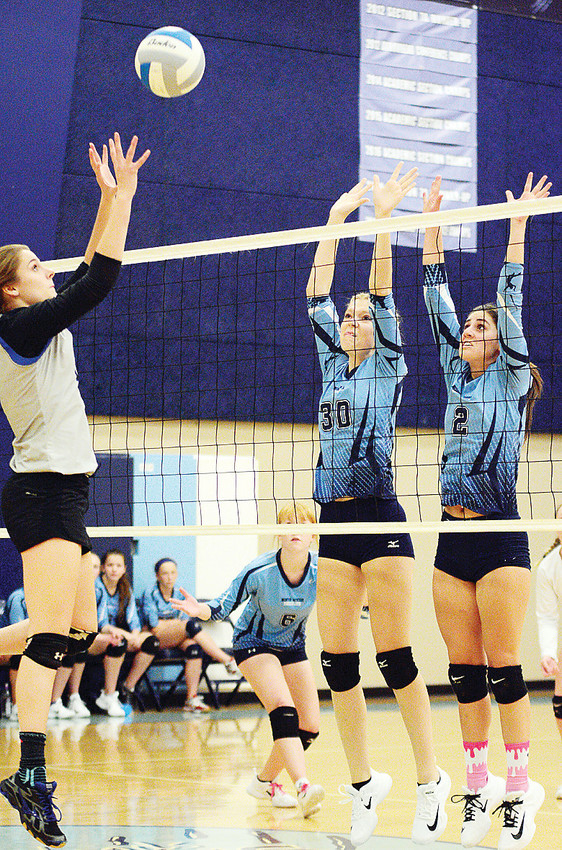 Karlyn Pierce and Kayla Tschida at the net for a block.