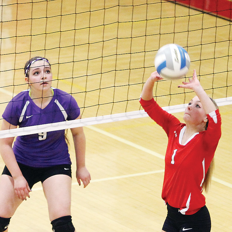 Ely junior Lida Dodge puts up a set during Wednesday night's playoff tilt with Hill City. Dodge was injured later in the game, which proved to be the season ender for the Wolves.