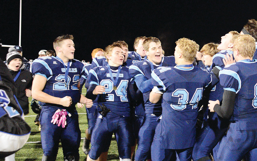 Members of the Grizzlies football team react after winning the Section 7 Nineman title last Friday, in Esko.