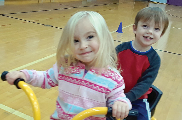 Children at the Little Eagles Childcare Center had some playtime in the elementary gym on Wednesday.