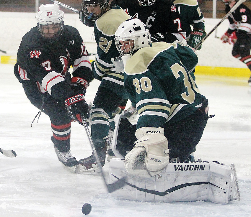 Ely's Matt Gerzin hits heavy traffic in front of the Bearcat net during their weekend series at home.