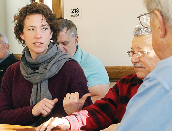 Duluth Mayor Emily Larson gestures while discussing   issues with the Ely City Council.