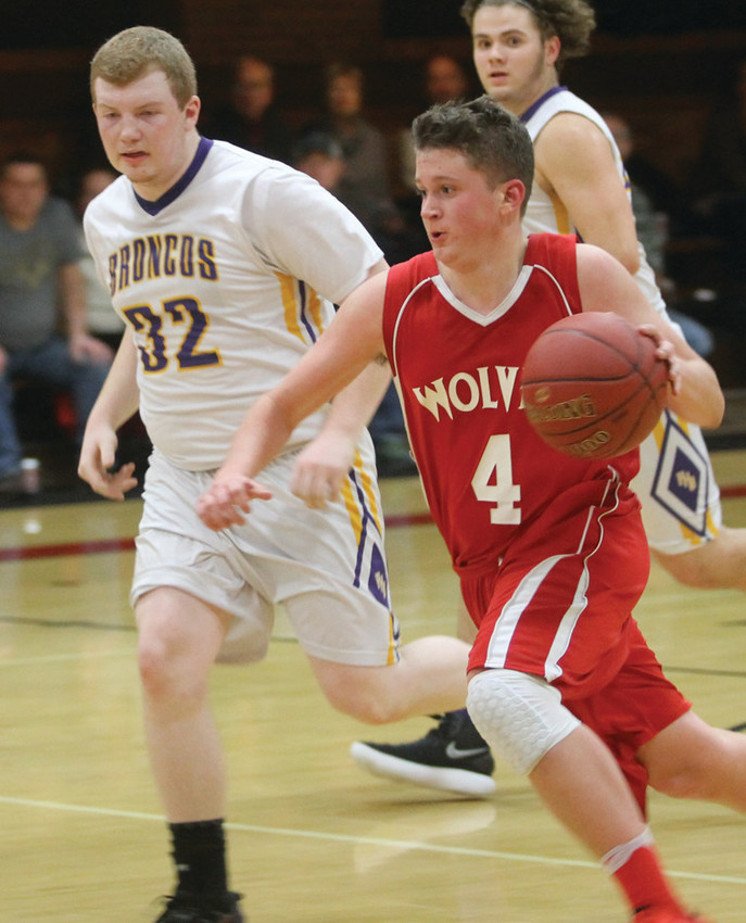 Senior guard Adam McDonald makes a move   on a fast break. He led the Wolves with 32 points in their game against International Falls last Friday.