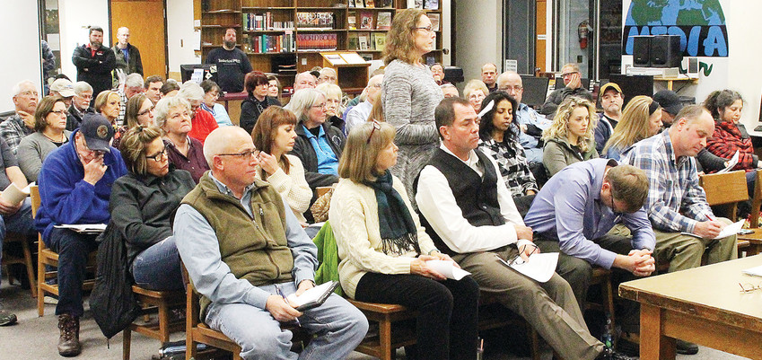 Ely residents filled the high school media center Monday night, top,  expecting the school board to make a decision on moving forward with a recreation center proposal.