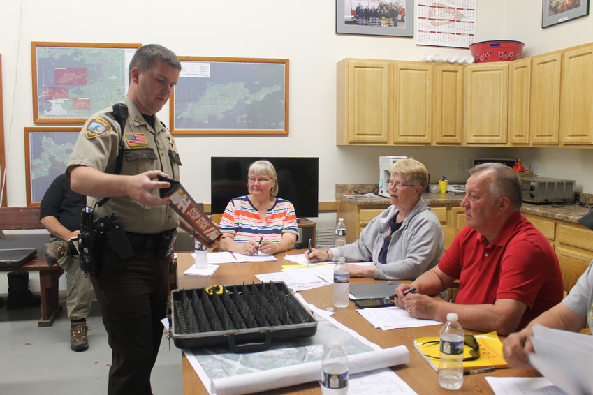 """Breitung Police Chief Jesse Anderson recently explained the uses of a """"stop stick"""" to members of the Breitung Town Board. Anderson has accepted a job with the Minnesota State Patrol and will be leaving Breitung next month."""