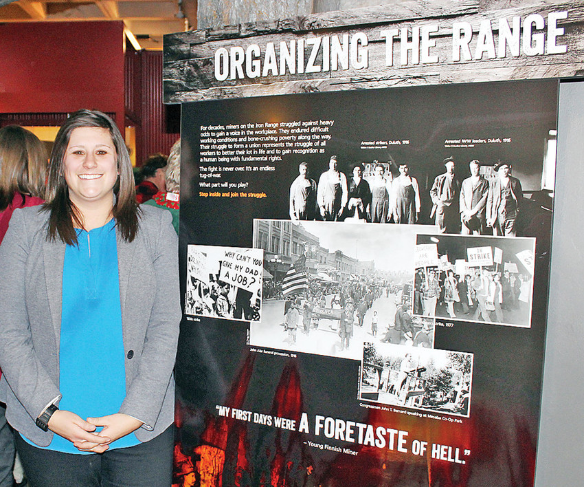 Curator Allyse Freeman, stands in front of the Minnesota Discovery Center's newest permanent exhibit that focuses on the often-violent labor history of the Iron Range.