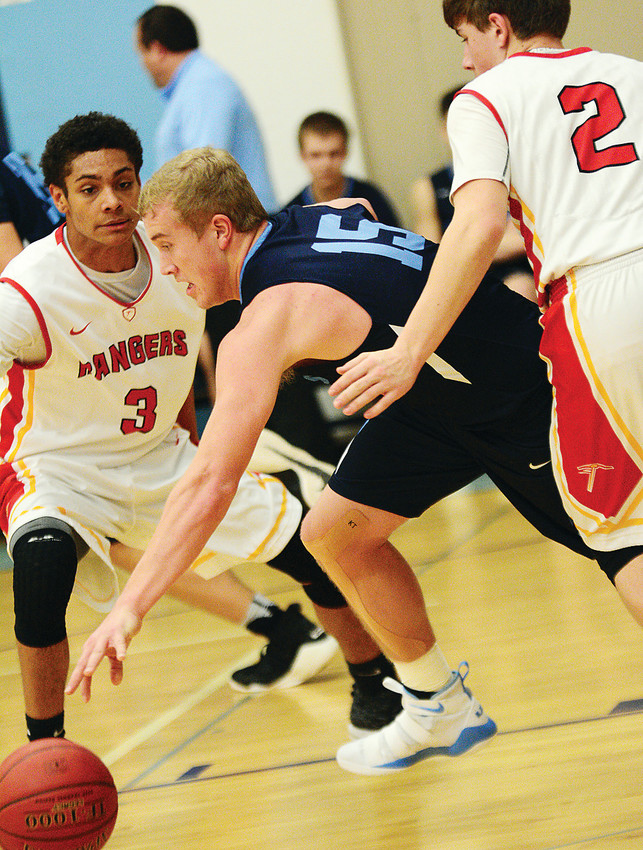 The Grizzlies' Tate Olson breaks through the MI-B perimeter during action last Friday at North Woods School.