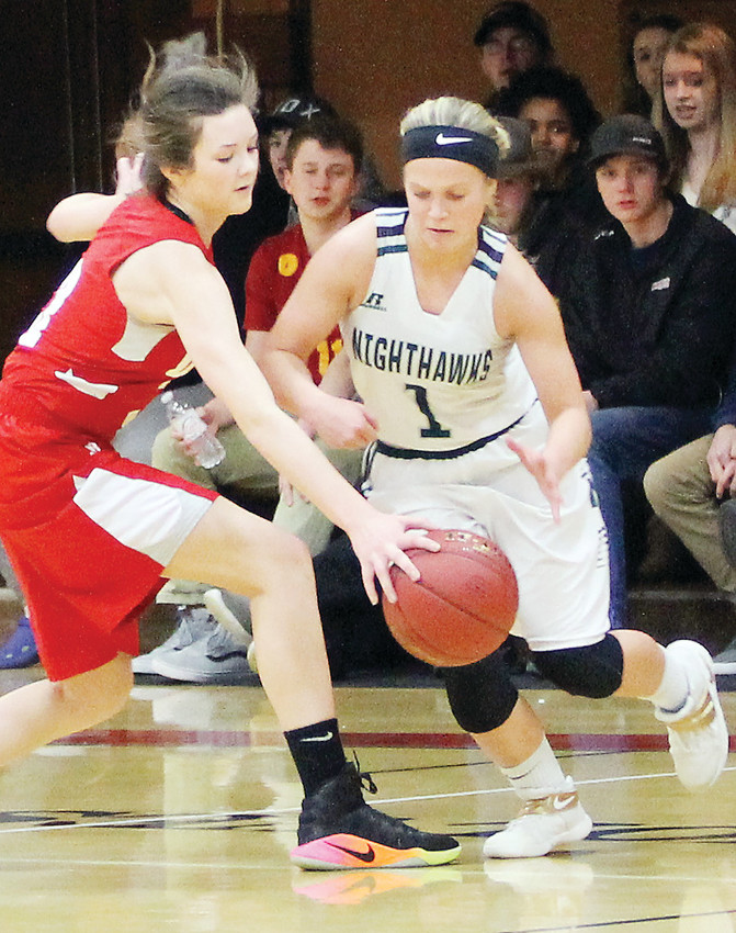 Sophomore guard Brielle Kallberg reaches in to steal the ball from the Nighthawks' guard Shayler Lislegard during Monday's game in Ely.