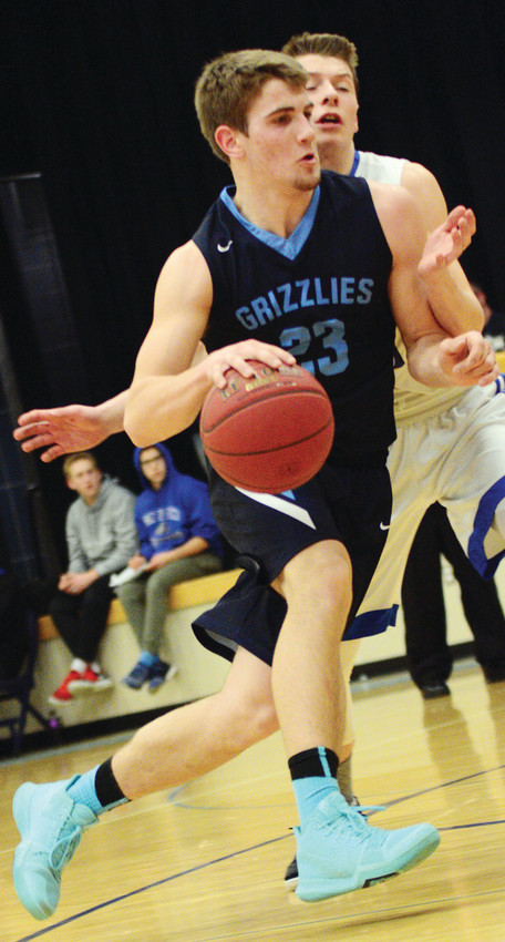 The Grizzlies' Chase Kleppe makes his move against a Carlton defender.