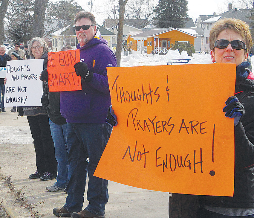 "Dozens of Ely-area residents participated in a ""March for Our Lives"" rally Saturday morning in Whiteside Park."