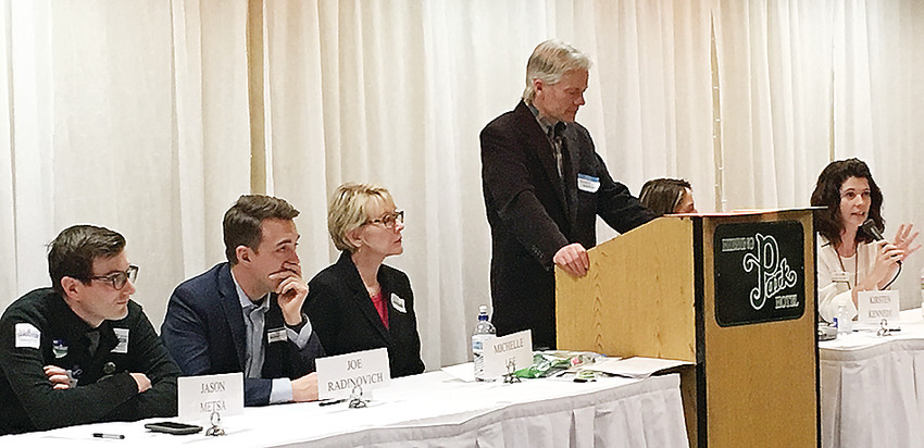 Leah Phifer (on right) makes a point during the March 17 congressional candidates forum held as part of the DFL Sixth District Convention in Hibbing. Also pictured (from left) are Jason Metsa, Joe Radinovich, Michelle Lee, moderator Marshall Helmberger, and Kirsten Hagen Kennedy.  M. Roach