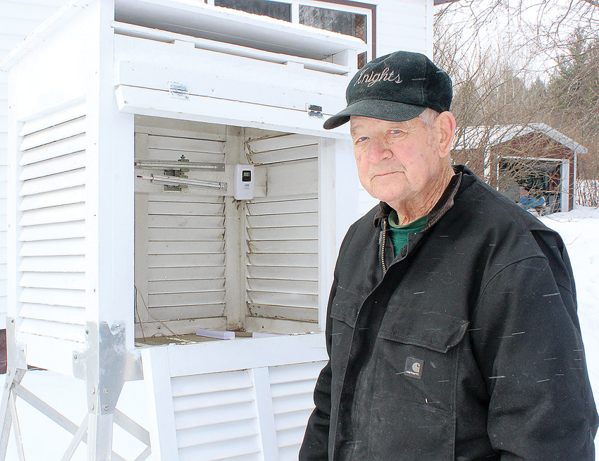 Roland Fowler stands in front of the official weather box from which he's recorded the brutally-cold temperatures in Embarrass for over 30 years.