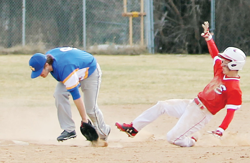 Ely's Nils Deremee slides into second base during last Thursday's game against Deer River.