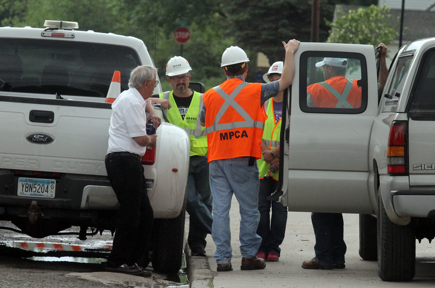 Ely Mayor Chuck Novak confers with state officials on the cleanup of a major gasoline leak.