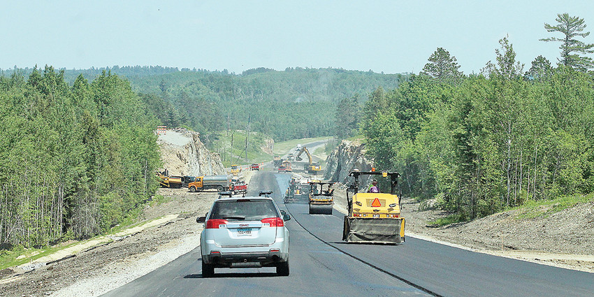 Vehicles were escorted on the new section of Highway 169 between Six Mile Road and  Eagles Nest last Thursday following a ribbon-cutting ceremony dedicating the road improvement project that took more than two decades to complete.