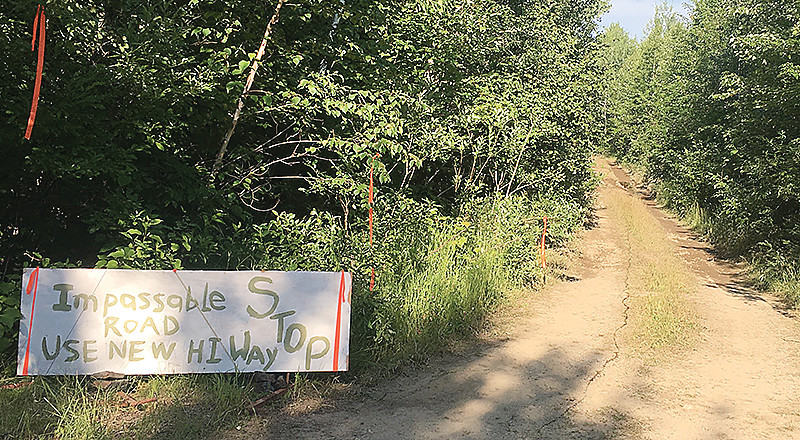 A homemade road sign greets drivers along Six Mile Lake Road.
