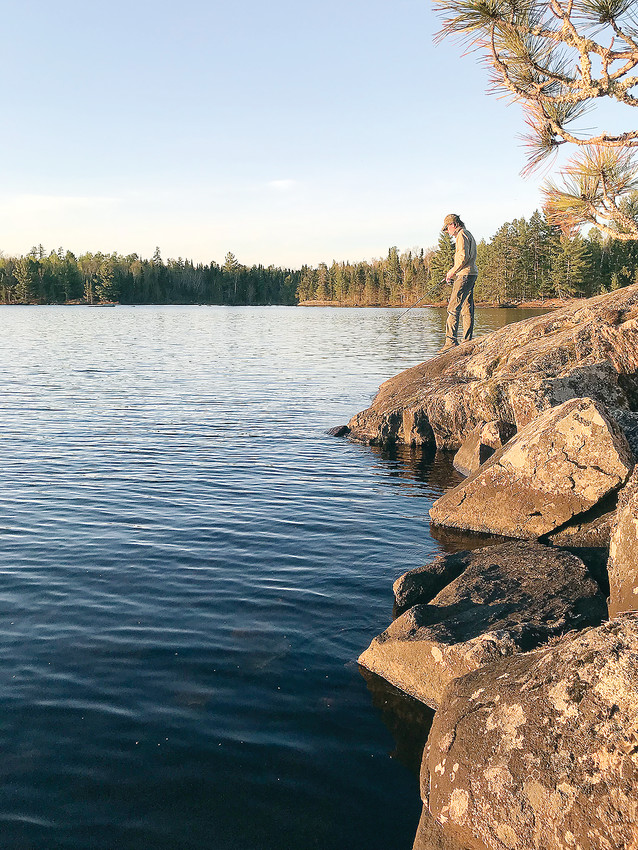 Fishing from shore on Cummings Lake in the Boundary Waters Canoe Area Wilderness