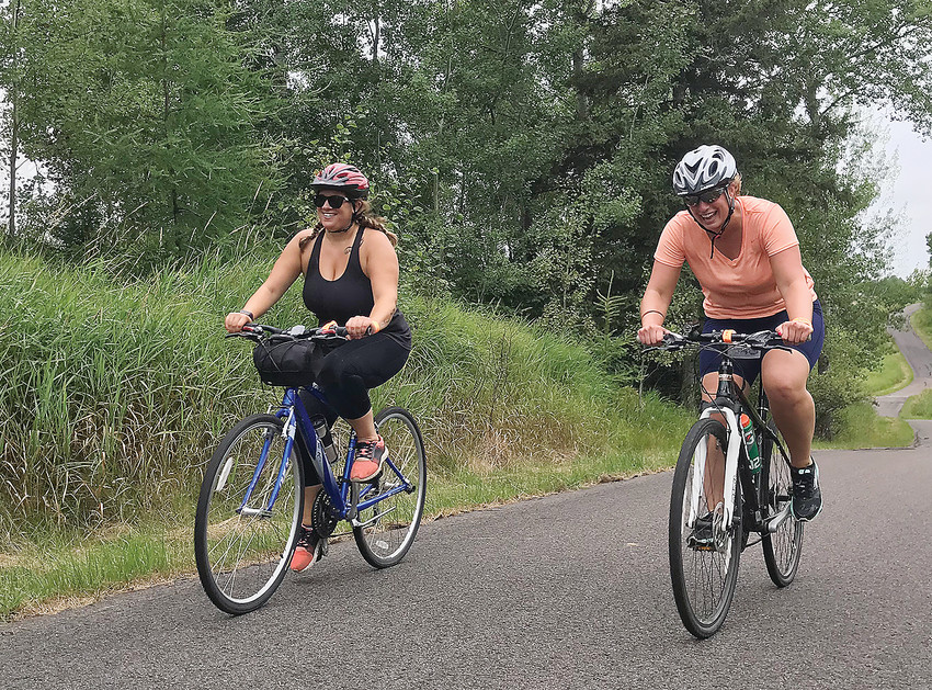Two of the nearly 700 participants in this past Saturday's   Mesabi Trail Tour, which extended from Bovey to Eveleth along the route of the Mesabi Bike Trail. Conditions were cool and cloudy for much of the morning, with steady rain   arriving around noon.