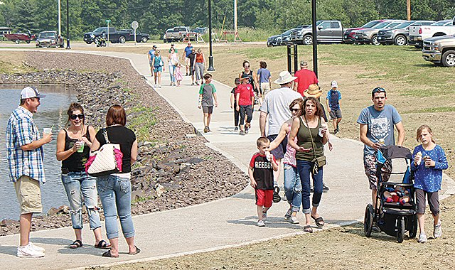 The new harbor trail was busy over the 4th of July, but the city is now seeking a way to pay for it.